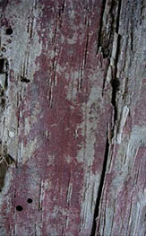 The red oxide on the cross frame.